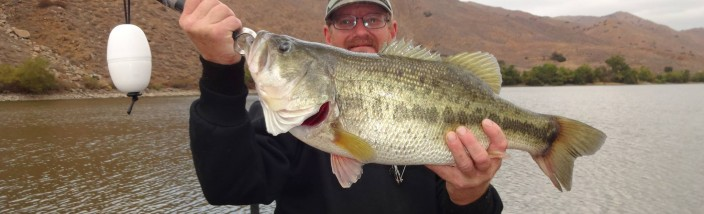 Randy Muirhead with 7 pound 10 ounce bass caught and released at corona lake